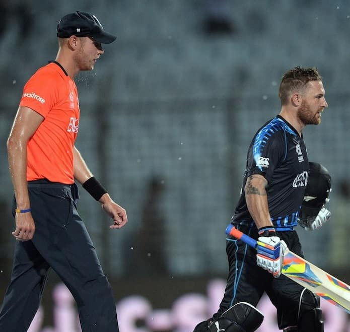 Stuart Broad and Brendon McCullum walking back to the pavillion after rain intervened